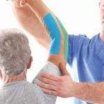 Physiotherapist giving therapy to old man